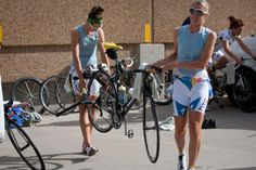 Alison Starnes | Emila Fahlin and Ally Stacher (HTC-Highroad) move a bike and ...