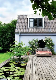 A cozy outdoor space with a small build-in lake. A beautiful garden where you can enjoy the summer.