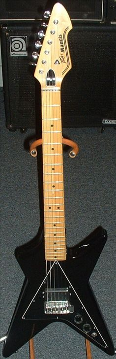 PEAVEY MANTIS I used to have one ;) I miss it :( it was metalic blue and was my fav guitar in the world <3