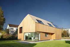 Low energy residence in Germany. Larch wood profiles cover the exterior facade of the Waldblick Residence, ensuring that the house displays a contemporary, durable design. The low energy home on the outskirts of Lucka, Germany, provides necessary heat and hot water thanks to the solar panels mounted on the south roof.