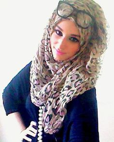The Beauty of Hijabs this is very cute the glasses just add to it :)