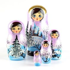 "Winter nesting doll - $51.99 This beautiful and authentic Russian nesting doll shimmers with a purple-pink color, as well as gold. It is accented with a soft blue hue and Winter trees surrounding an old church. The detail on this doll was crafted wonderfully, from the eyelashes of the main blue-eyed matryoshka, to the hair curls on the smallest doll. Nearly 6 1/2"" tall and gloss finished. Colors vary slightly"