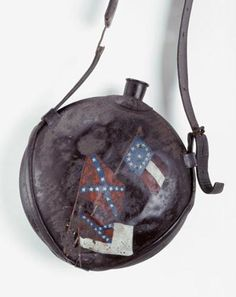 """Alfred May carried this United States Army M1858 canteen during the Civil War. May was born in Pitt County and enlisted in Company F, Sixty-first Regiment North Carolina Troops in August 1862. Company F was known as the """"Trio Guards"""" because it included soldiers from Pitt, Wilson, and Green counties. ~ NC Museum of History"""