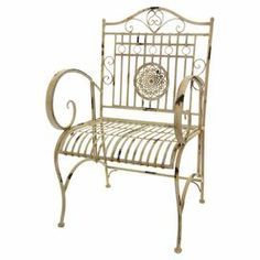 "Crafted of wrought iron and showcasing a medallion accent, this distressed arm chair brings classic style to your sunroom or three-season porch.  Product: ChairConstruction Material: Wrought ironColor: Distressed whiteFeatures: Can be used both indoor and outdoorsDimensions: 38.5"" H x 23"" W x 22"" D"