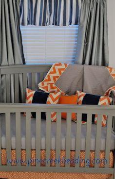 Orange & Navy sports theme crib bedding in a grey nursery