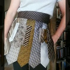 Stand out at your next vendor event with these unique upcycled tie half aprons from Desert Pearl Designs. They have two pockets and will fit most body types. Come find yours!