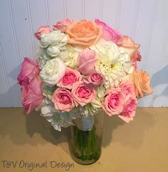 Bridal bouquet in soft pinks, light orange, and white.