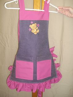 Little Girl Apron, made from Denim and pink ruffles and pockets.   Cute embroidered bear.