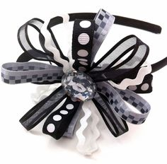 Girl's Headband with Black and White Patterned Ribbon and Jeweled Center. $10.00, via Etsy.