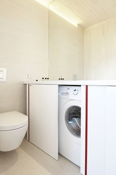 Clever hiding of washer/dryer in half bath!
