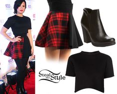 Demi Lovato: black crop tee, tartan skirt ... Demi Lovato posed at the arrivals of the 93.3 FLZ Jingle Ball yesterday wearing a Etre Cecile Cropped Tee ($195.00), a Fausto Puglisi Half Plaid Banded Skirt (sold out) and her Prada Sport Leather Ankle Booties ($684.00). You can get similar boots from Chinese Laundry ($59.95) and a similar top from American Apparel ($13.00).