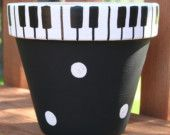 Piano Keys Hand-Painted Flower Pot - super cute for the music lovers in your life Clay Pot Projects, Clay Pot Crafts, Craft Projects, Diy Crafts, Craft Ideas, Painted Clay Pots, Painted Flower Pots, Hand Painted, Painting Terracotta Pots