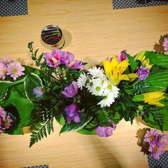 Need a runner? Use greens! .  .  .    #catering #cateringlife #cateringservice  #calvincatering #calvincollege #creativediningservices #creativedining #calvin  #centerpiece #flowers #art #floral #runner #tablerunner #greens #daisies #lily #purple #yellow #green #lunch #vip #beautiful