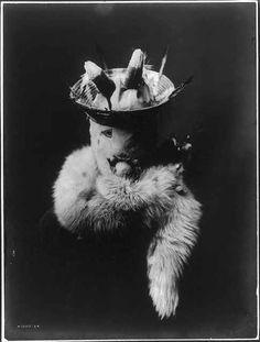 Navajo man wearing mask of Ganaskidi, god of harvests, plenty, and of mists. 1905