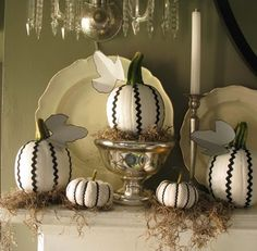 Spanish moss with black and white pumpkins.
