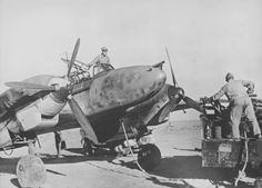 Photo: Service of the German Messerschmitt fighter Bf.110 at the airport in North Africa