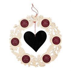 ABOUT ME Cut-out wreath with 6 picture frames for x pictures and a hanging heart chalkboard. Includes a string for hanging. x x Chalk included. Winter's Tale, Hanging Hearts, Avon, Picture Frames, Wreaths, Gift Ideas, Christmas, Gifts, Yule