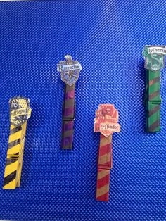 Easy DIY Harry Potter bookmarks! Just spray paint,   Add stripes with marker, and glue on a house crest!!