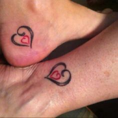 Mother - daughter tattoo with three hearts instead of one
