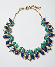 Anthropologie Lotus Arrow Necklace Natural stones and handpainted enamel are both hallmarks of Lele Sadoughi's eponymous jewelry collection, which is inspired by the renewed fascination with ancient Egypt's architecture and design in the 1920s. Each piece, like this striking necklace, embodies a geometric-deco look and brings to mind the vibrant culture of northeast Africa. #Fashion #Jewelry #Necklace #Anthropologie