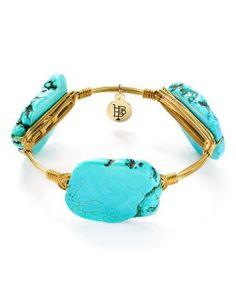 Aqua howlite is stunning in irregular cut on this Bourbon & Boweties bangle, wire-wrapped in a shining setting. Wear this beauty with minimal accents to give the vibrant stones all the more impact. |