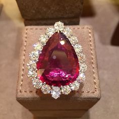 A very Fine 22.50 ct Rubelite Ring set in 18kt Gold and accented by surrounding diamonds by