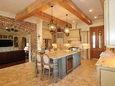 Madden Home Design - French Country house plans, Acadian house plans. Really like this island