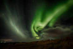 Yesterday's Northern Lights - I went out for a drive yesterday evening and the Northern Lights found me close to the golf course in Seltjarnarnes. I was able to be alone with them for 5 minutes before the auroras haunters came to the party.