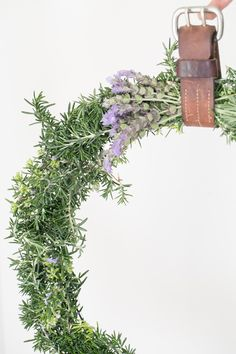 This is the best smelling and most relaxing DIY rosemary wreath you'll ever make. A fun and easy holiday craft that will add charm to your holiday decor.