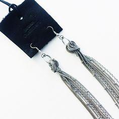 Urban Outfitters silver tassel earrings Cute silver tied tassel earrings from urban!  No trades Urban Outfitters Jewelry Earrings