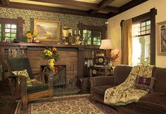 "The brick-tile fireplace, integrated bookcases, ""honest"" trim, and ceiling beams are typical of bungalow interiors; note the harmonious colors. Photo by Philip Clayton–Thompson."