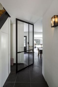 Glass and aluminium pivot door by ANYWAYdoors.