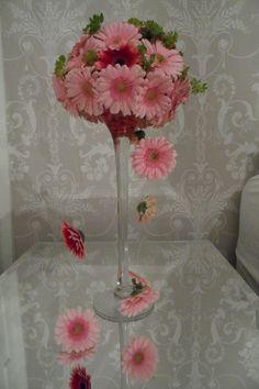 Unusual gerbera martini glass wedding decor arrangement with gerbera 'daisy chains' on silver wire