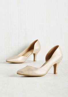 The Future Looks Chic Heel in Gold. Gazing into our crystal ball, we see you confidently flaunting these metallic gold kitten heels - and a consequent wave of compliments - to come! #gold #prom #wedding #bridesmaid #bride #modcloth