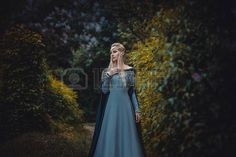 52505346-the-beautiful-elf-in-a-long-blue-dress-is-walking-in-a-green-forest-full-of-branches---princess-in-v.jpg (450×300)