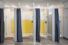 Austin Bouldering Project. Lilianne Steckel Interior Design. Industrial gym design. yellow subway tile; white subway tile; canvas shower curtain; concrete floors; gym showers