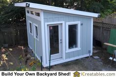 Trim is installed on the modern shed exterior. The battens are installed over the siding joints and trim is installed around the windows