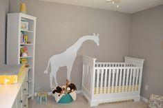 ah i love the giraffe peeking into the crib. adorable!