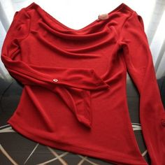 Vizio red stretchy shirt full slits up sleeves Vizio red stretchy shirt full slits up sleeves with button closure pointed side hem and cowl neck size small excellent condition Vizio Tops