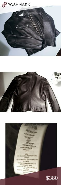 NWOT- MICHAEL KORS - Moto Jacket 100% Lamb Leather Incredibly soft 100% Lamb Leather sexy moto style jacket with silver zippers. I would keep this jacket but it does not fit me. I have a habit of buying stuff smaller in hopes I'll drop some pounds. Never got a chance to wear it out. I took the labels off. It is brand New and rare style to find. You can dress it up or down. True to size. Beautiful on any body type. Cannot go wrong with this beauty. Michael Kors Jackets & Coats