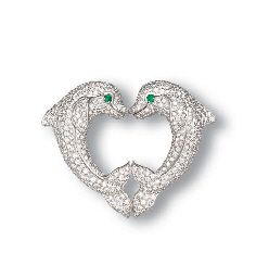 A DIAMOND AND EMERALD DOLPHIN CLIP BROOCH, BY CARTIER