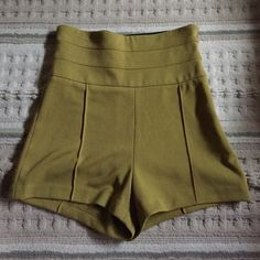 Green high waisted shorts Green high waisted shorts. Never been worn. Took the tag off and noticed a rip in the seam. I'm sure it's an easy fix. But I rather just sell them. Super cute. Forever 21 Shorts