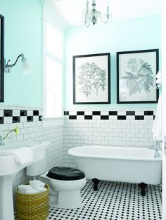 Black and white tile bathroom, with teal walls, a chandelier, and even a black toilet lid, Love!