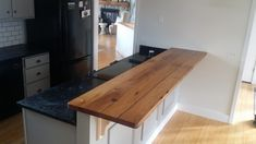 All the worm holes and cracks where filled with clear epoxy and sanded smooth with the top. Kitchen Bar, Chestnut Kitchen, Countertop Design, Kitchen Tops, Kitchen And Bath Remodeling, Countertops, Bar Countertops, Oak Kitchen, Wood Bar Top