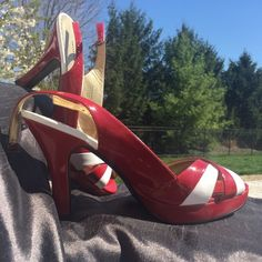 NWOT Steve Madden heels Never worn. Cute red and white patent leather almost candy striper look heels. Very Small scuff on one heel  as seen in photo.  Adjustable buckle strap around the ankle. The heel measures 4 1/2 inches. Fun and flirty Madden Girl Shoes Heels