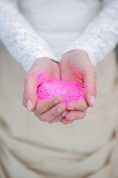 Love the idea of flinging colour everywhere haha - Bride holding pink holi powder