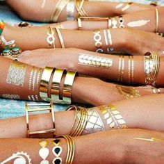 Flash Tattoos: How to Wear Them and Look Cool | StyleCaster Bangles, Bracelets, Cartier Love Bracelet, Studio Design, Interiors, Electric, Metallic, Interior Design, Patterns
