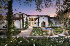 spanish style house, my favorite style with clay colored tiled roofing and white exterior. love it