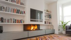 Why not combine two focal points and install a TV above a fireplace? The 572 TV contemporary modern gas fireplace is a masterpiece of form and function..
