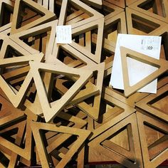 Triangles. Fresh from the wood shop. . . #triangles #shapes #woodworking #wood #geometry #manufacturing #workshop #components #quantity